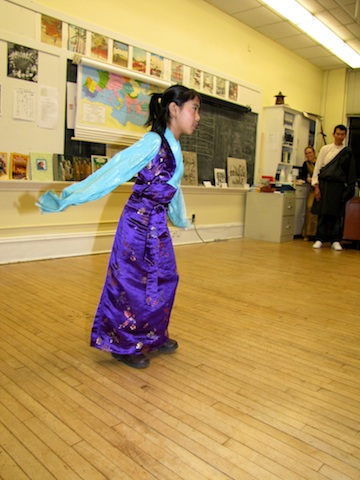 Young Tibetan girl performs a traditional dance at the Halifax Shambhala School.