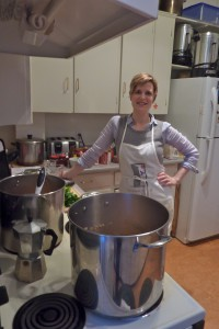 Heather Gaskill cooking up a meal for Queer Dharma night.